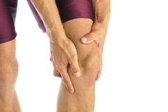 Knee injury. Male athlete in pain clutches his knee Royalty Free Stock Images