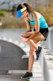 Knee injury. For athlete runner. woman in pain after hurting her leg while training for fitness marathon stock photo