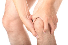 Knee injury. Man with knee injury on white background Stock Photography