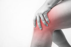 Knee injury in humans .knee pain,joint pains people medical, mono tone highlight at knee.  Stock Photo