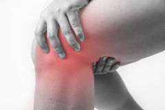 Knee injury in humans .knee pain,joint pains people medical, mono tone highlight at knee.  Royalty Free Stock Photos