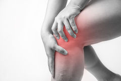 Knee injury in humans .knee pain,joint pains people medical, mono tone highlight at knee.  Royalty Free Stock Photography