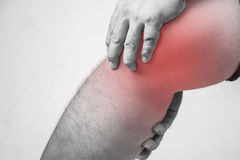 Knee injury in humans .knee pain,joint pains people medical, mono tone highlight at knee.  Stock Image