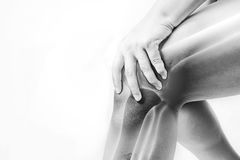 Knee injury in humans .knee pain,joint pains people medical, mono tone highlight at knee.  Stock Photography