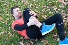 Injury running concept . Man having knee pain while training Royalty Free Stock Photos