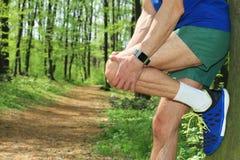 Knee injury, Man runner with knee pain Stock Photos