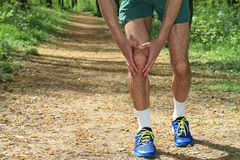 Knee injury, Man runner with knee pain Royalty Free Stock Photo