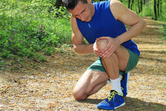 Knee injury, Man runner with knee pain Stock Photos