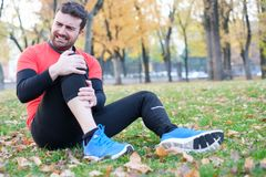 Knee injury and man runner with knee pain Stock Photos