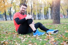 Injury running concept . Man having knee pain while training Royalty Free Stock Images