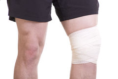 Knee injury with sports bandage Royalty Free Stock Photography