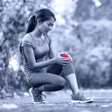 Knee Injury - sports running knee injuries on woman Royalty Free Stock Image