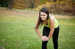 Knee injury - woman in pain after sport Stock Images