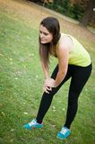 Knee injury - woman in pain after sport Stock Image