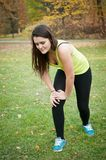 Knee injury - woman in pain after sport Royalty Free Stock Photos