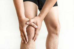 the knee man holds on suffering from pain in knee Closeup. The l Stock Photo