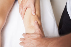 Knee massage Royalty Free Stock Photography