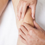 Knee massage Stock Photos