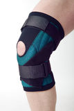 Knee pad. Male leg with textile knee pad on it Stock Photos