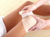 Knee pain. Knee joint  pain. Bandage. Health Stock Photo