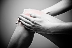 Knee pain. Young woman having knee pain royalty free stock images