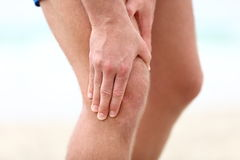 Knee Pain. Sports running knee injury in male runner Royalty Free Stock Photos