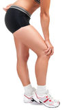 Knee Pain. Young woman with pain in her knee Stock Photo