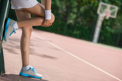 Knee pain. Copy-spaced image of human legs having knee pain on the sports ground Stock Photography