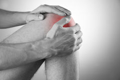 Knee pain in men. On gray background stock images