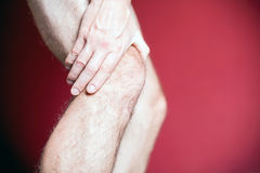 Knee pain and recovery massage Stock Photo