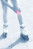 Knee pain during roller blading Royalty Free Stock Photography