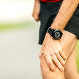 Knee pain running injury Stock Photo