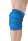 Knee protection in games on the male leg. Close-up. On a white background Stock Photo