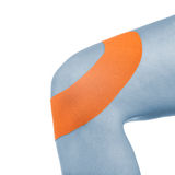 Knee treated with tape therapy Royalty Free Stock Photography