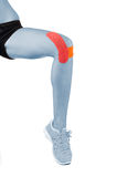Knee treated with tape therapy Royalty Free Stock Images