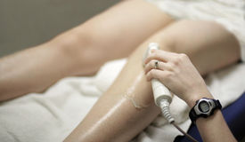 Knee treatment Royalty Free Stock Images