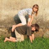 Kneeing kids Stock Image