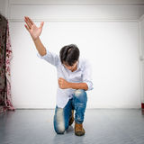 Kneel to praise. Royalty Free Stock Images