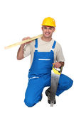 Kneeled carpenter with a handsaw. Royalty Free Stock Photos