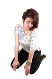 kneeling девушки пола Стоковая Фотография