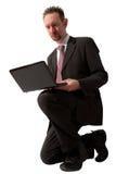 Kneeling Businessman Using Computer Stock Photos