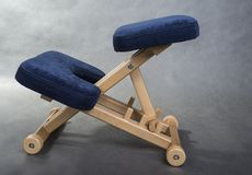 Kneeling chair for healthy sitting. Knee chair support your back Royalty Free Stock Image
