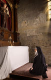 Kneeling in a chapel Stock Photography