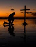 Kneeling Before The Cross Stock Photos