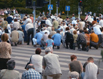 Kneeling crowd Stock Photo