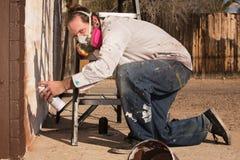 Kneeling Graffiti Artist Royalty Free Stock Photo