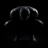 A kneeling man Stock Photos