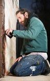 Kneeling Man Spray Painting Royalty Free Stock Image