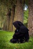 Kneeling monk Stock Photo