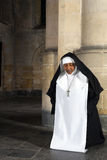 Kneeling nun Stock Images